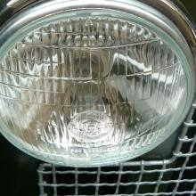 the land rover headlamps were made by Lucas