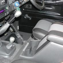 The defender land rover now has the interior trimmed with top quality carpeting and the half leather seats have now been fitted
