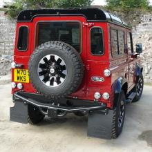 The rear of the land rover defender has now been fitted with the diamond cut alloy wheel with a BFG tyre .
