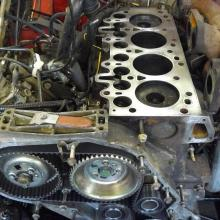 land rover 300 tdi engine with the cylinder head removed and the timing belt can also be seen