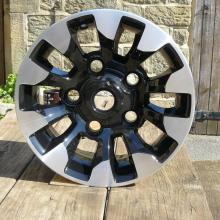 The pub table at Jake Wright's with a land rover alloy wheel on top in the sunshine