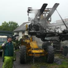More cleaning of the engine as it is now suspended on the forklift