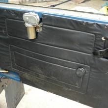 The 90 V8 land rover still has it's original rear door trim