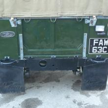 The land rover series 2a has mudflaps fitted to the rear chassis cross member
