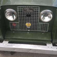 the series 2 land rover has got headlamps in the radiator grill