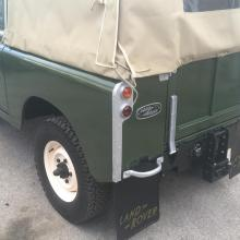 The hood is held onto the land rover with ropes
