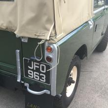 early land rover's had got white letters on black number plates