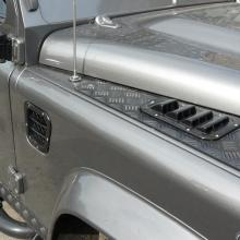 A silver land rover wing fitted with an air scoop