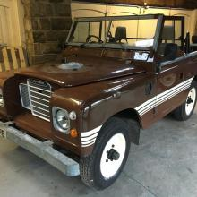 The Russet Brown Series 3 land Rover is inside our showroom