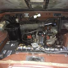 Under the bonnet of the land rover series 3 is very tidy