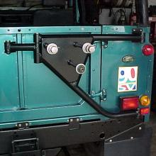 A land rover defender SVX special edition 90 at jake Wright's with  a swing away wheel carrier on the back