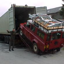 Here is a container at jake wright specialist in land rover  being loaded with a 110 land rover bound for canada and can be seen with a spare chassis on it's roof rack