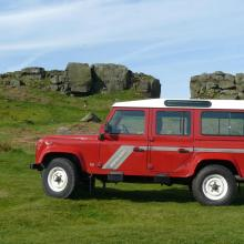 THE COW AND CALF ROCKS MAKE AN IDEAL BACK DROP FOR THE PHOTO OF THE LAND ROVER