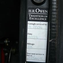 THE DEALERS SERVICE STICKER IS ATTACHED TO THE A POST