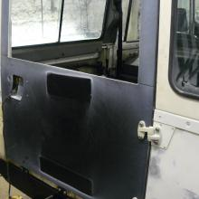 The rear end door is being fitted to the land rover defender 110