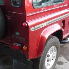 The rear right hand corner of the land rover defender