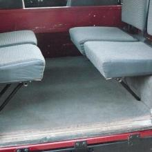Here is a nice picture showing the rear of the land rover with side facing seats