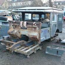 land rover series 107 station wagon is seen trial fitting the body and the bulkhead from Australia onto the replacement chassis