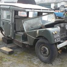 land rover series one  107 station wagon now broken in half as it is being removed from the trailer in jake wright land rover's yard