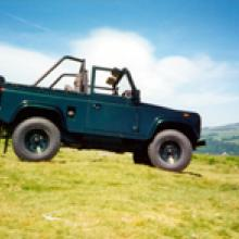 A loveley sunny day near the cow and calf rocks on Ilkley moor with a land rover open top defender.