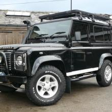 LAND ROVER DEFENDER FOR SALE AT JAKE WRIGHT with roof rack and has all sorts of extras fitted