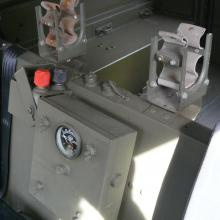 The original gun clips are in between the front seats on the land rover lightweight