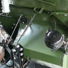 The original land rover horn was mounted on the footwell