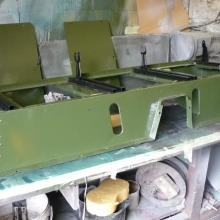 the land rover seat box was prepared and painted deep bronze green