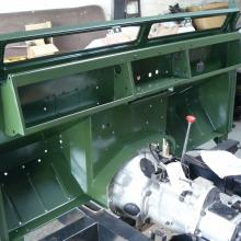 The land rover bulkhead has now been painted inn bronze green and fitted to the chassis