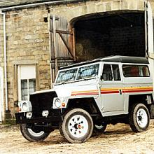 A Jake Wright refurbished Land rover lightweight standing outside a barn in Burley in Wharfedale , near Ilkley in West Yorkshire  in the 1980's