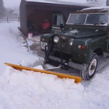 It is nice to see an old series 2a land rover in the snow with plough attached ready for some land rover snow ploughing