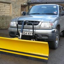 hERE AT JAKE WRIGHT'S IS A TOYOTA PICKUP FITTED WITH A SNOWPLOUGH