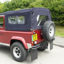 A defender 90 with black mohair canvas top