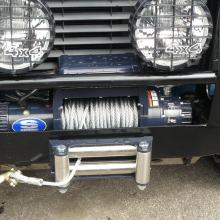 A defender fitted with a Winch and spot lamps in the yard at jake wright's