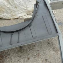 range rover classic side panel has now been repaired and primed raedy for fitting