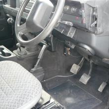 The drivers side of the interior of the land rover defender