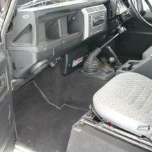 THE INTERIOR OF THIS LAND ROVER IS IN VERY NICE CONDITION WITH CLOTH SEATS