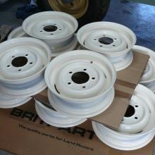 A stack of land rover wheel rims after being blasted and repainted