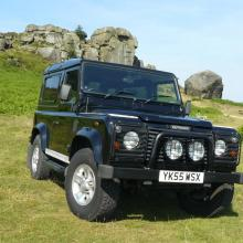 The Cow and Calf rocks can be seen in the background of this land rover defender at Ilkley