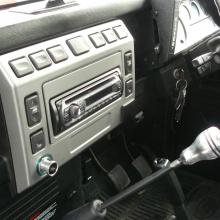The interior of the land rover double cab is in very good condition  and this picture shows the dashboard