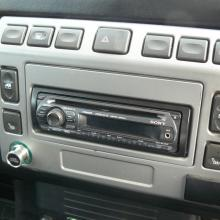 The inside of the cab shows a CD player in the dashboard of the land rover double cab pickup