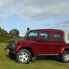 This picture shows a very nice Land Rover 110 double cab pick up on Ilkley moors