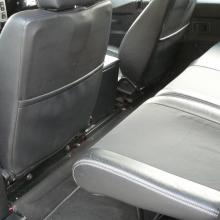 The intereior of the land rover double cab is shown here looking at the rear seats