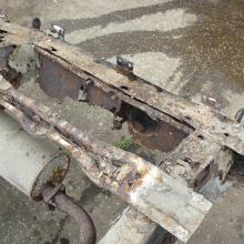 Another view of the very rusty rear cross member and body x member's on the series 2a land rover