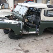 land rover series 2 body is removed from the chassis and is now on the ground