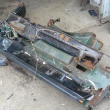The corroded bulkhead is now on the ground from the series 2 land rover