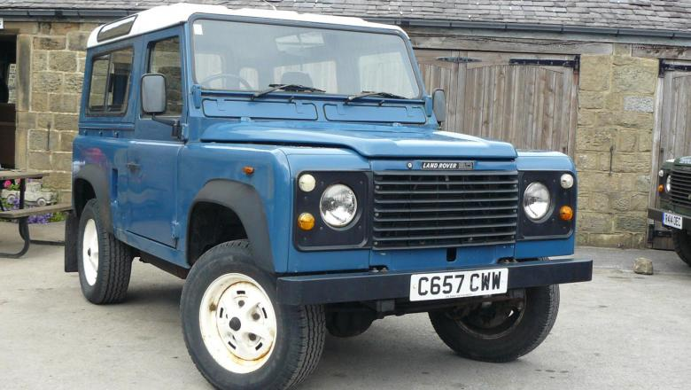 A very nice V8 land rover 90 is seen outside the workshop at Jake Wright's