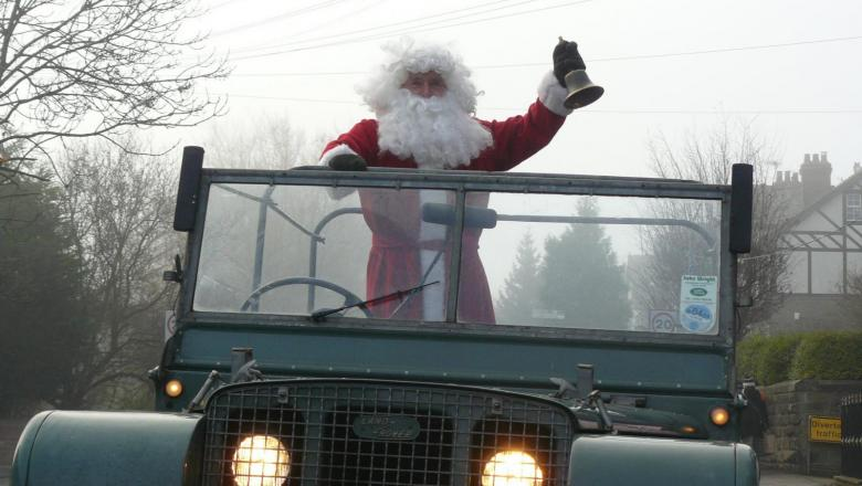 Father Christmas in a series one land rover