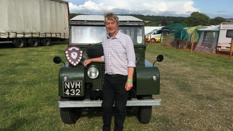 """Here is a land rover 107 station Wagon with a Trophy standing on the wing at Masham Steam rally , the prize was for """" Best Restored Land Rover"""", John wright is standing at the side of it ."""