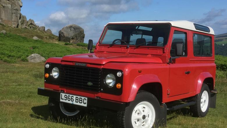 A very nice Land Rover defender is seen here on Ilkley Moor at Cow and calf Rocks